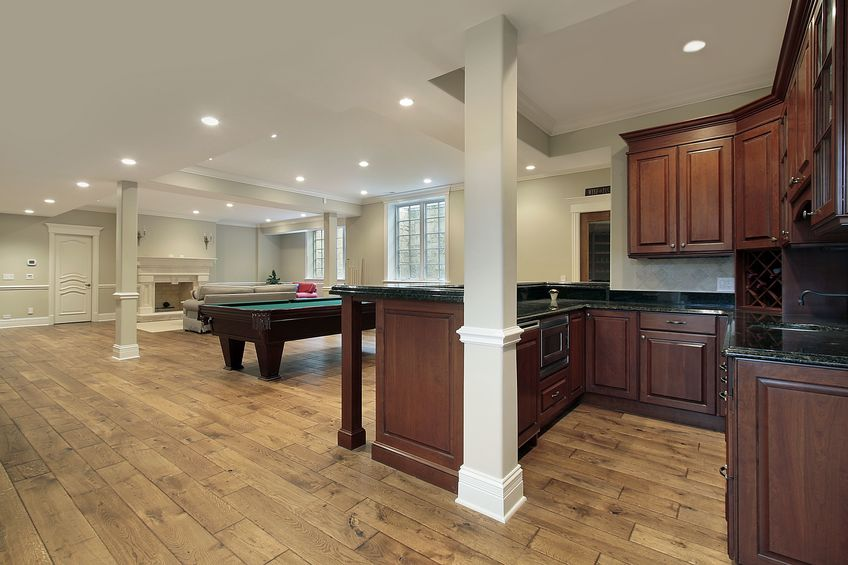 beautiful finished basement with bar and fireplace